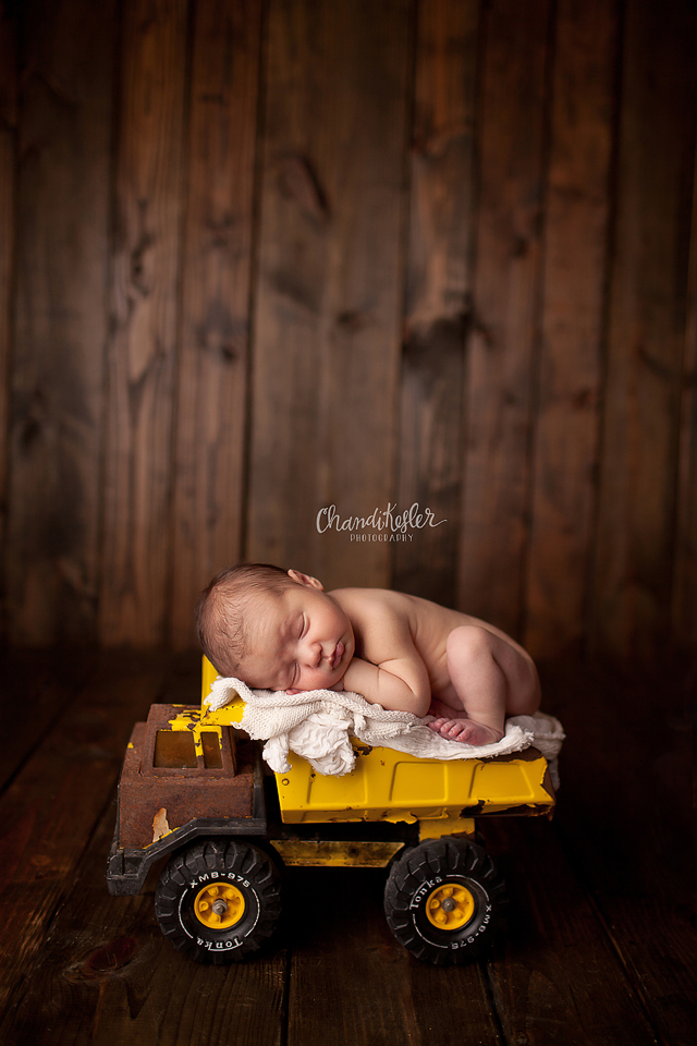 Clinton Illinois Newborn Photographer - Newborn dump truck prop pose ideas