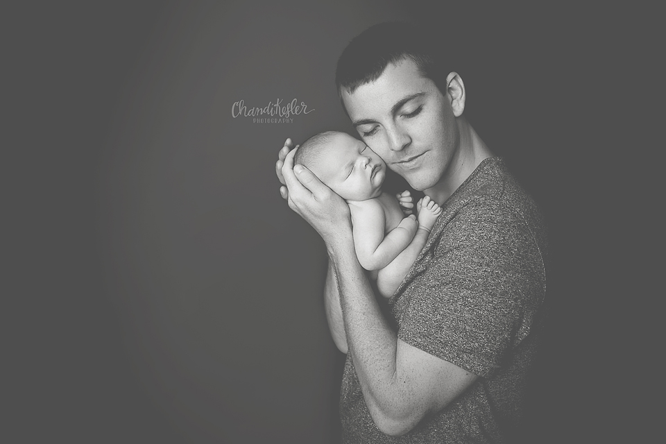 Streator Newborn Photographer -  newborn with dad poses